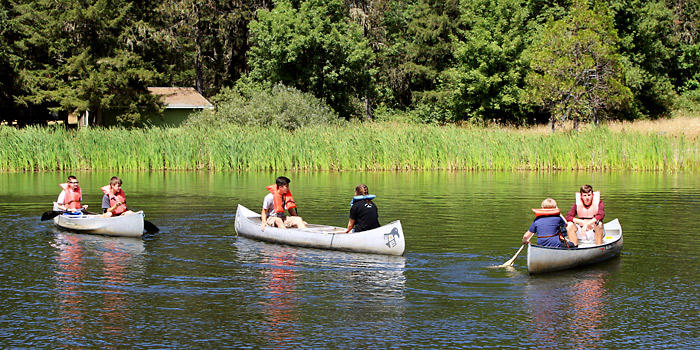 Campers enjoying their free time canoeing with friends