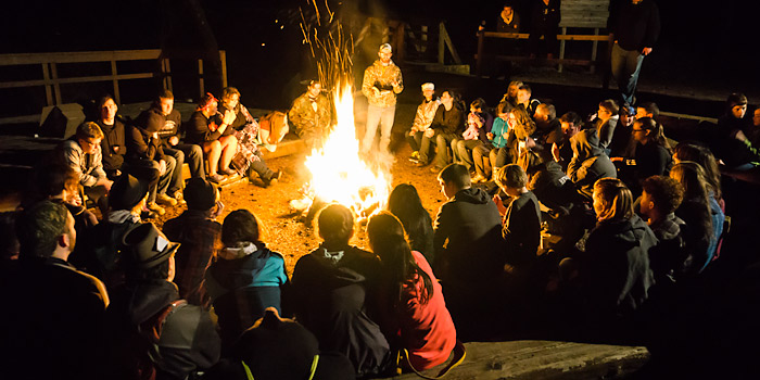 Winter Retreat Campers listen to a bible lesson at the Campfire