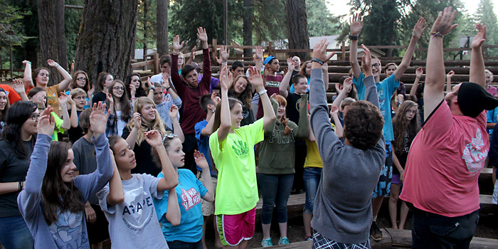 7th and 8th grader campers sing fun songs at the end of the day at Camp Yamhill