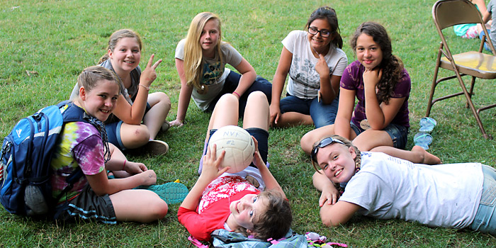 Campers from 5th and 6th grade camp enjoying the meadow during free time
