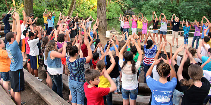 5th and 6th Grade campers singing fun songs curing campfire activities