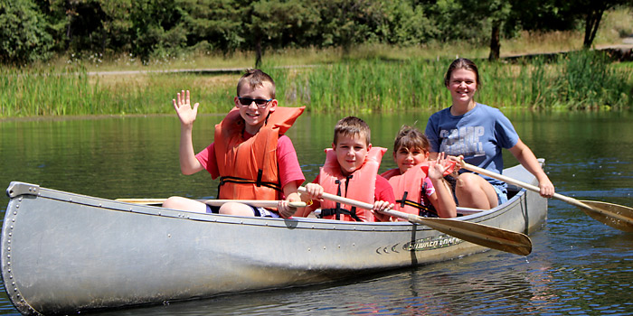 3rd and 4th Grade campers use the canoes during free time at Camp Yamhill